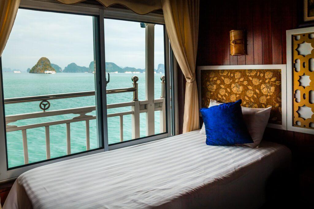 Bed in cruise ship cabin. Halong Bay, Vietnam